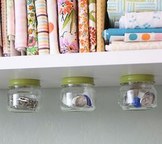Under The Shelf Jar Storage! This tutorial uses drill, nuts, bolts, etc., but I'm thinking why not glue a magnet on the underside of the shelf and other part of the magnet on jar lid... making it easier to install and won't leave your shelves full of drill holes! ~April
