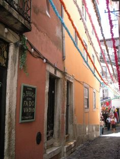 One Day in Lisbon: A colorful alleyway with streamers in Alfama.