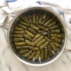 Rolled grape leaves filled with beef and rice  Ever tried them? So warm and hearty and bursting with flavor  Nothing like the cold veggie ones you sometimes find in Greek salads. #f52grams #feedfeed @thefeedfeed #beautifulcuisines #huffposttaste #buzzfeedfood