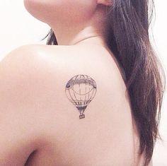 Simple hot air balloon tattoo design by Taps