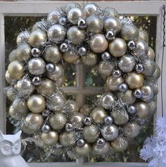 DIY: Dollar Store Wreath- tutorial shows how to make this wreath from $ Store ornaments, tinsel & a wreath form.