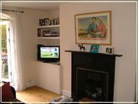 Contemporary fitted alcove cabinet with floating shelves above. Alcove Cupboards, Built In Cupboards, Alcove Tv Unit, Fitted Cabinets, Cabinet Companies, Chimney Breast, Living Spaces, Living Room, Bookshelves