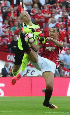 Zlatan Ibrahimovic of Manchester United in action with Kasper Schmeichel of Leicester City during the FA Community Shield match…