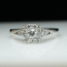 This flower cluster diamond engagement ring is the stuff of vintage dreams.