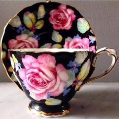 Beautiful black teacup with pink roses by Paragon