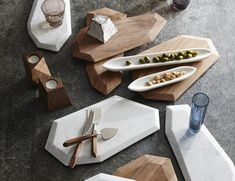 Got a festive celebration at home? Here's a great way you can serve cheese or hor d'ouerves by using these Faceted Marble + Rosewood Serving Pieces.