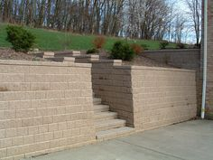 Pittsburgh retaining walls installation by PGHSW uses retaining wall block like Omni Stone and Versa-lok for it's retaining wall construction. Retaining Wall Construction, Retaining Wall Steps, Privacy Walls, Wall Installation, Pittsburgh Pa, Landscape Design, Outdoor Living, Fire, Patio