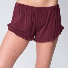 Brandy Melville Maroon Vodi Shorts One size fits all, super stretchy, soft, and flowy. Bought it last summer but it's just been sitting in my drawer (maybe worn once if that) which is why it looks like it needs to be ironed! But when you put it on it'll stretch out and look smooth again. Bundle for 15% off or buy with the light blue pair for $14 for both! Brandy Melville Shorts