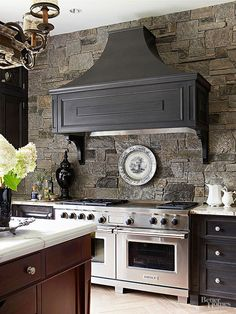 Design takes a dramatic turn in this kitchen, with all-black cabinets. It takes a brave designer to attempt such a feat -- and a smart one to pull off the look without making the room feel dark and dreary.