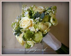 lovely lemon and cream bouquet lily of the valley artimis roses ranuncula arabica and senneccio maritima.