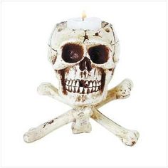 Skull resting on crossbones resin candleholder