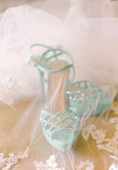 Turquoise shoes under a veil, perfect for a bridal boudoir photo shoot.