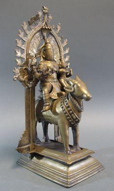 Lot 84 - AN UMA-MAHESVARA SHRINE Deccan, Southern India, circa 18th century cast brass, in four pieces,