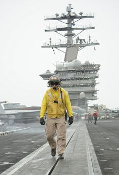 GULF OF OMAN (June 13, 2013) – Lt. Brandon Jenkins, a Cumberland, Md., native inspects catapult number one prior to flight operations aboard the aircraft carrier USS Nimitz (CVN 68). Nimitz Strike Group is currently deployed to the U.S. 5th Fleet area of responsibility conducting maritime security operations and theater security cooperation efforts. (U.S. Navy photo by Mass Communication Specialist 1st Class Michael D. Cole/Released)