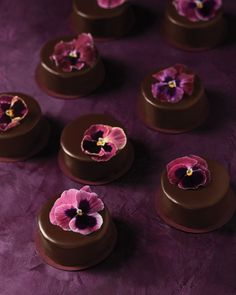 Give petite treats a little something extra, and you'll prove the saying about good things coming in small packages. Have your caterer pour dark-chocolate ganache over individual desserts, then drop a single stemless pansy on top of each when the coating cools (but before it hardens) to set it. The glossy surface makes a dramatic backdrop and tastes like heaven, with or without blooms—pansies aren't just gorgeous, they're also edible. (And so are nasturtiums, which would work nicely…