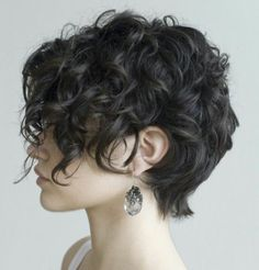 Cute curly pixie cut.  Yup, looking to chop it off again.