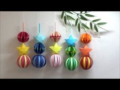 How to make a ball decoration . makes the paper strip ball and then adds two more types to make a bright hanging ornament . Ball Decorations, Decoration Table, Wire Crafts, Diy And Crafts, Diy For Kids, Crafts For Kids, Japan Crafts, Paper Balls, How To Make Lanterns