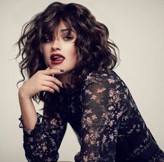 Shay Mitchel long curly bob and bangs
