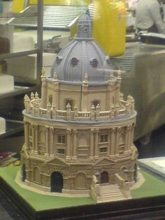 Cake Wrecks   Cake Wrecks  If it's literary enlightenment you're craving, let's browse the stacks at the Radcliffe Camera, or Rad Cam, as all the cool kids call it, a reading room of the Bodleian Library at Oxford University.  Submitted by Andrew R. and made by The Cake Shop
