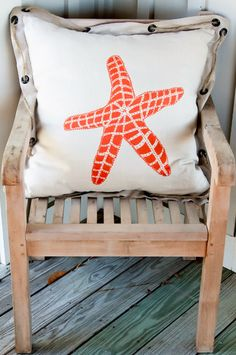 Coastal starfish pillow and teak chair. Just missing me & a cocktail!