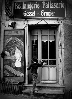 "Willy Ronis - Though this pic seems ""so Paris"", this kid don't live in a zoo called France : this is his bakery. For Willy Ronis, born and died in Paris, this pic is just our life... without romantism; but full of tenderness"