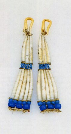 """Ear rings of Dentalium pretiosum shells and glass trade beads, worn by an Inuit girl.  Collected at Hershell Island 