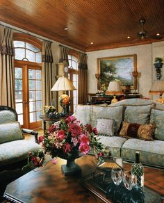 Incredible room...love the seating arrangement, arched window over the French doors, curtains (Henredon Furniture) yet has a formal feel to it also...