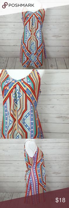 "A'Gaci tribal print dress A'GACI tribal print dress in excellent condition   Flowy fitting and flattering, the colors on this dress are gorgeous!  Bust measures approx 19"" across  Total length is approx 34""  Love the item, but not the price? Offers are always welcome 🤗 a'gaci Dresses"