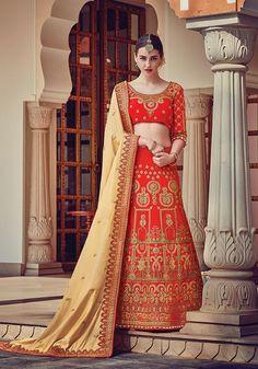 Red traditional bridalwear designer embroidered lehenga choli with contrast beige dupatta