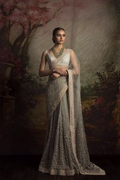 This saree featured in pastel green color net fabric. The border of the saree is handcrafted in zardozi work and skirt is in sequin and thread work. The blouse is in pastel green color dupion silk. This saree can be customized in any color of your choice. Lehenga Sari, Sabyasachi Sarees, Net Saree, Bridal Lehenga, Saree Wedding, Indian Sarees, Anarkali, Indian Attire, Indian Ethnic Wear