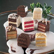 Learn how to make these precious stenciled petit fours with our step by step picture tutorial This recipe will make a total of 16 petit fours Fancy Desserts, Just Desserts, Delicious Desserts, Yummy Food, Frozen Desserts, Baking Recipes, Cake Recipes, Dessert Recipes, Cupcakes