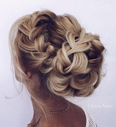 Wedding updo hairstyle idea 8 via Ulyana Aster - Deer Pearl Flowers / http://www.deerpearlflowers.com/wedding-hairstyle-inspiration/wedding-updo-hairstyle-idea-8-via-ulyana-aster/
