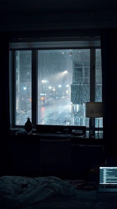 Photo by Gian Cescon on Unsplash laptop computer left turned-on on bed inside room during rainy night