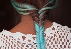 a twist on a classy hairstyle: blue dyed fishtail braid
