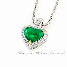 Centre stone is a heart shaped emerald with 53 = GH/VS – SI round brilliant cut diamonds in the halo and bale of an white gold pendant Emerald Pendant, Gold Pendant, Pendant Necklace, The Ordinary, Heart Shapes, Diamond Cuts, Halo, Turquoise Necklace, Centre