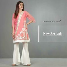 The Vintage inspired coral, asymmetrical style shirt with ivory floral Embroidery is a trendsetter. #Beautiful #Formals #SummerCasual #ZainabChottani #DesignerWear #LuxuryFashion #Inspiration #Original #Unique #PakistaniFashion #PakistaniCelebrities  ✨