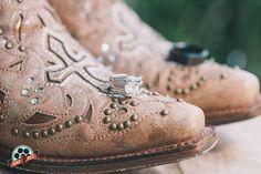 Boots + Rings  Photo by Rad Red Creative www.radredcreative.com #makeyourweddingrad #weddingphotography #bouquet #redbouquet #tampaphotography #tampaweddingphotography #tampawedding #tampaphoto  #ring #weddingring #engagementring #ringinbouquet #countrywedding #rusticwedding #bootshot #bootsring #wishingwellbarn