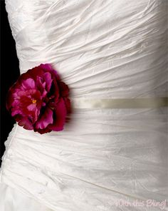 Add a pop of color with a floral sash. This fuchsia peony sash is available at @withthisbling1 #BridalSash