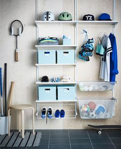An ALGOT storage system propped with sports equipment.