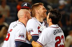 ATLANTA, GA - JUNE 01: Freddie Freeman #5 of the Atlanta Braves celebrates with Tyler Flowers #25 and Chase d'Arnaud #23 after his walk-off homer in their 5-4 win over the San Francisco Giants in the 11th inning at Turner Field on June 1, 2016 in Atlanta, Georgia. (Photo by Kevin C. Cox/Getty Images)