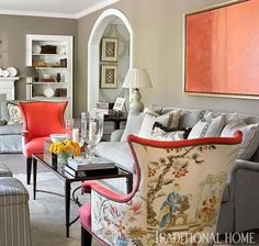 A subtly glossy greige is the perfect backdrop for fiery coral...
