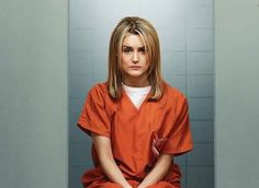 """OK, we've officially had one too many all-night """"Orange Is the New Black"""" marathons -- we're starting to see things. Like these photos of Taylor Schilling, who plays the series' incarcerated antiheroine Piper Chapman, at a luncheon for the Hollywood Foreign Press Association yesterday."""