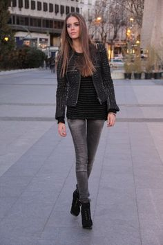 Gray jeans, black top and boots