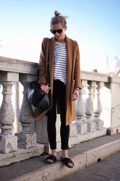 top knot, camel coat, striped tee, satchel, cropped black denim & slide…