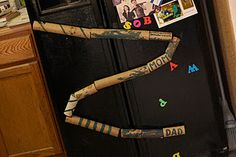Cardboard Tube Marble Run. Each tube has its own magnet, so they can be rearranged to form different tracks.