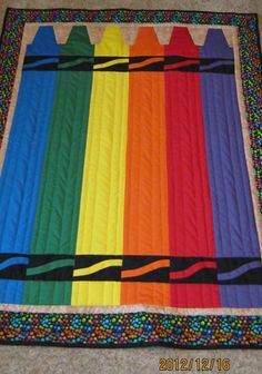 This quilt was made by Lois Grove. It is her own design. She created it for a great-grandson. It is all in cotton and channel quilted to give dimension to the crayons. It is just so nice. Thank you, Lois, for sharing it with our quilting community! 24blocks.com