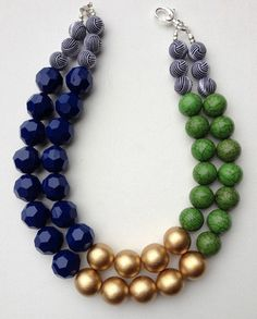 The Emma - emerald green howlite, gold and navy blue geometric bead statement necklace. Measures approximately 19 inches and length and is Bead Jewellery, Beaded Jewelry, Jewelery, Jewelry Necklaces, Boho Jewelry, Bracelets, Jewelry Gifts, Jewelry Accessories, Handmade Jewelry