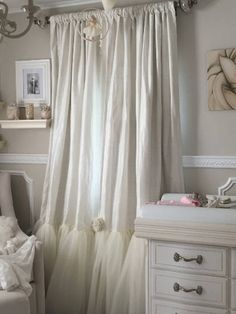 Similar to its namesake in ball-gowns and evening wear, dressmaker details are the added frill of Tulle!! Pricing for the following options -- starting at: >One Silk Panel 50 w x 84L with ONLY tulle bottom $195 Adding ONE fabric made rosette in coordinating fabrics- $35 Pricing given