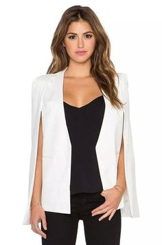 The beautiful Ice Chic Cape features a cape style blazer with a deep plunge neckline and asymmetric hem. Faux pockets in front. Fully lined. - Material: Polyester - Color: Black or White - Hand Wash C