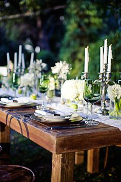 The wood table and vintage candelabras look really lovely together.